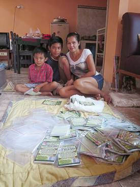 Ibu Ketut Alit with sons (Putu Nanda and Kadek Arya). Photo by Brenda Hinton, Bali, November 2013