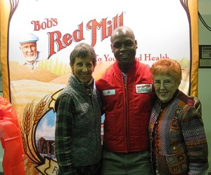 Visiting Bobs Red Mill with my mother. Everyone wears a red vest, except the visitors. (Brenda, our tour guide Al and Mom)