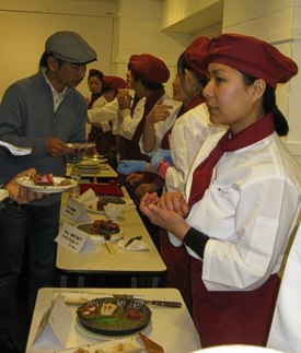Students greeting guests with tastings of their amazing creations.